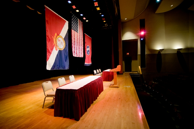 Facility Tour A Auditorium 1 stage with flagsWL